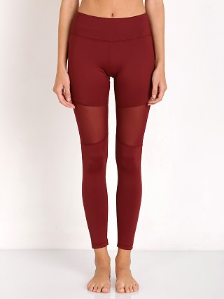 Model in burgundy Varley Sycamore Tight