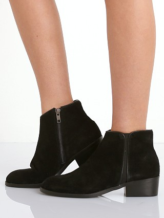 Model in black SOL SANA Maverick Boot