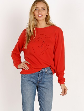 Model in poppy potassium LNA Clothing Bisous Sweatshirt