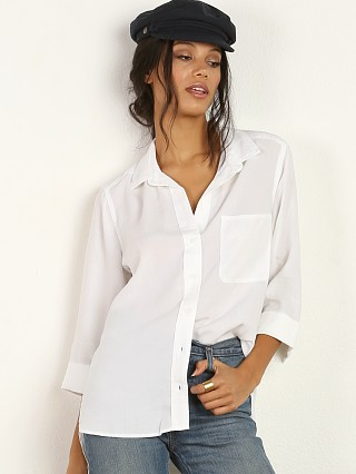 Model in white Bella Dahl Shirttail Button Down