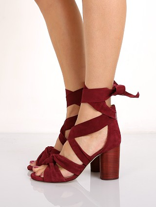 Model in crimson Raye Myra Sandal