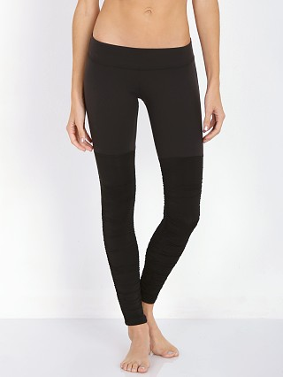 Model in black Beyond Yoga Leg Warmer Legging