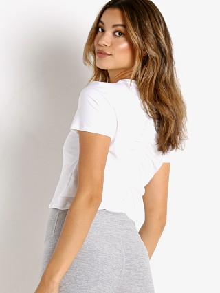 Model in cloud white Beyond Yoga Ruched Down Cropped Tee