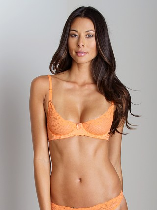 Model in orange Timpa Duet Lace Underwire Demi Bra