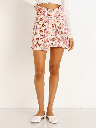 Model in tea rose For Love & Lemons Willa Cargo Skirt