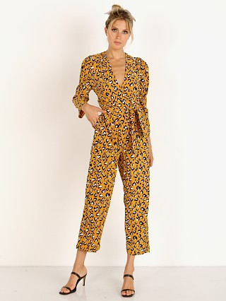 Model in mustard Cleobella Draper Jumpsuit
