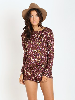 Model in crimson floral Beach Riot Chulo Long Sleeve Romper