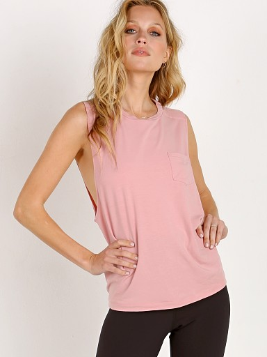 Model in blush Reebok Nature Tank