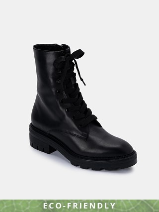 Model in black Dolce Vita CLEAR Sustainable Lottie Combat Boot