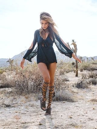 Model in faded black Somedays Lovin Road Trip Playsuit