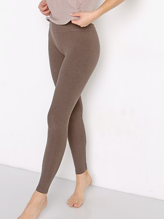 Model in cocoa brown Beyond Yoga Spacedye Midi High Waisted Legging