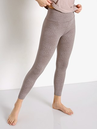 Model in soft cocoa Beyond Yoga High Waisted Midi Legging