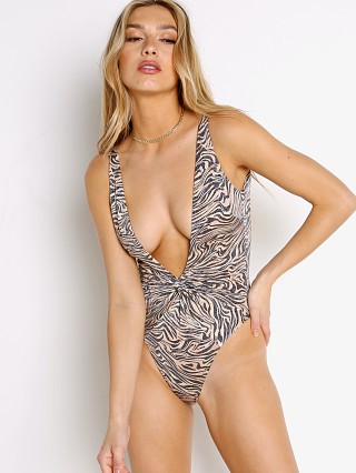 Model in animal instinct L Space Stormi One Piece