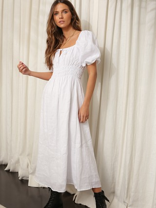 Model in plain white Faithfull the Brand Maurelle Dress
