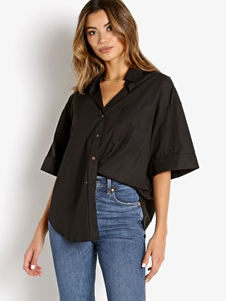 Model in black poplin Faithfull the Brand Marquis Shirt Black