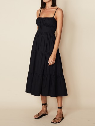 Model in black poplin Faithfull the Brand Alexia Midi Dress Black
