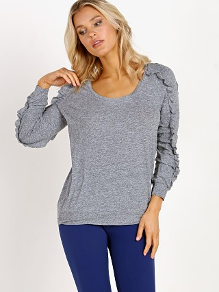Model in heather Lanston Sport Ruffle Long Sleeve Pullover