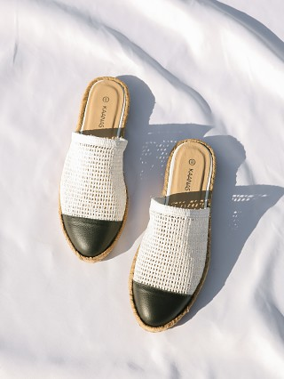 Model in white Kaanas Palau Fishnet Mule Espadrille