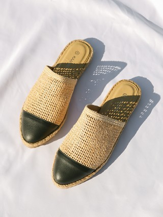 Model in custard Kaanas Palau Fishnet Mule Espadrille