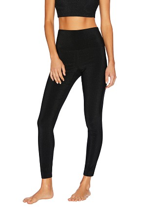 Model in black glitter Beach Riot Glitter Ayla Legging