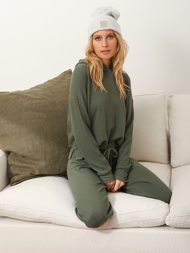 Model in army green LNA Clothing Raven Waffle Hoodie