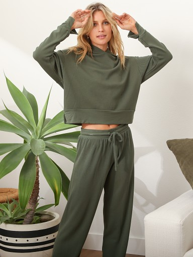 Model in army green LNA Clothing Waffle Jogger