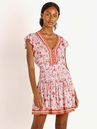 Model in pink naif Poupette St. Barth Mini Dress Rachel Smocked