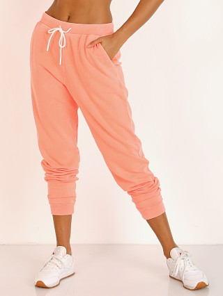 Model in neon coral Splits59 Harlow Sweat Pants
