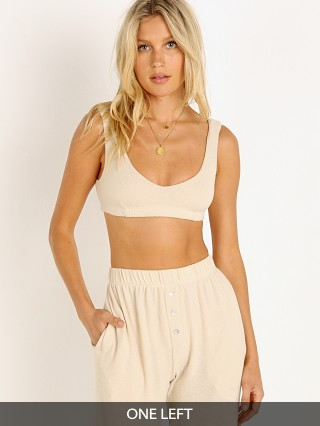 Model in creme DONNI. Sweater Bralette