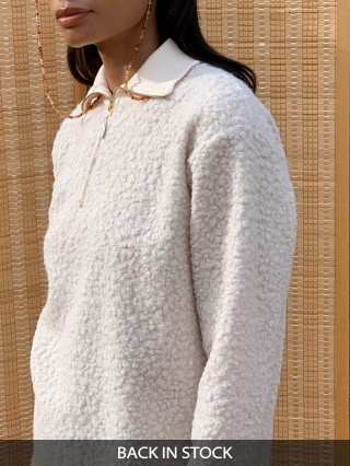 Model in creme DONNI. Curly 1/2 Zip Pullover