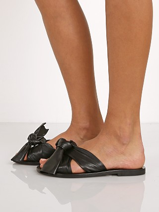 Model in black SOL SANA Nina Wrap Sandal