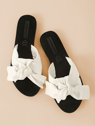 Model in white SOL SANA Nina Wrap Sandal