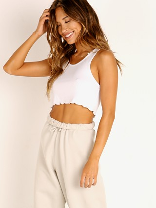 Model in white Joah Brown Scalloped Crop Tank White