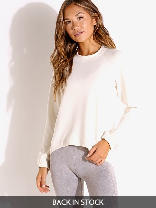 Model in cream NUX Sleek Sweatshirt