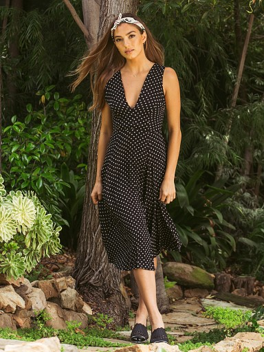 Model in polka black Cleobella Jessie Midi Dress