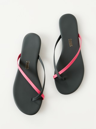Model in neon pink Tkees Riley Sandal