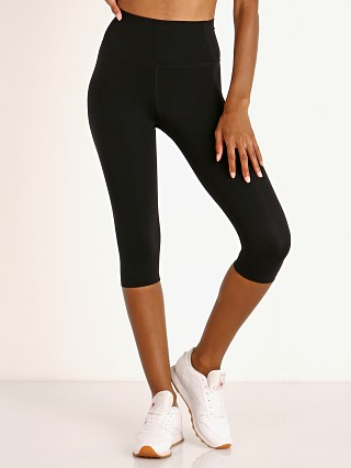 Model in black SPLITS59 Airweight High Waist Capri