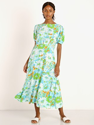 Model in gardone floral Faithfull the Brand Beline Midi Dress