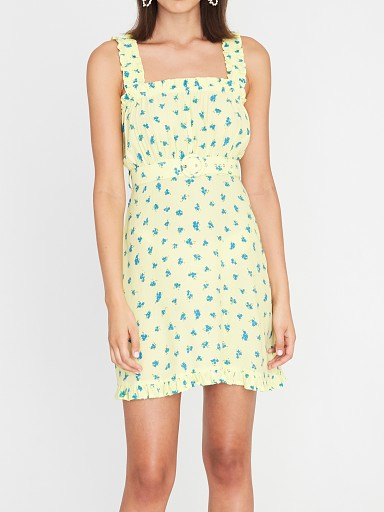 Model in luda lemon floral Faithfull the Brand Mid Summer Mini Dress