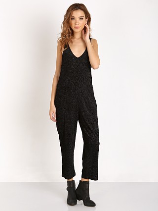 Model in black Somedays Lovin Morrison Velvet Jumpsuit