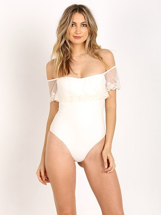 Model in white Solkissed Celeste Bodysuit