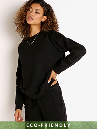 Model in black Richer Poorer Recycled Fleece Crew Sweatshirt
