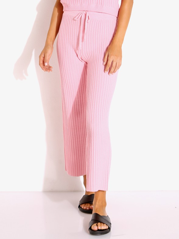 Model in pink Rue Stiic Shae Knit Pant