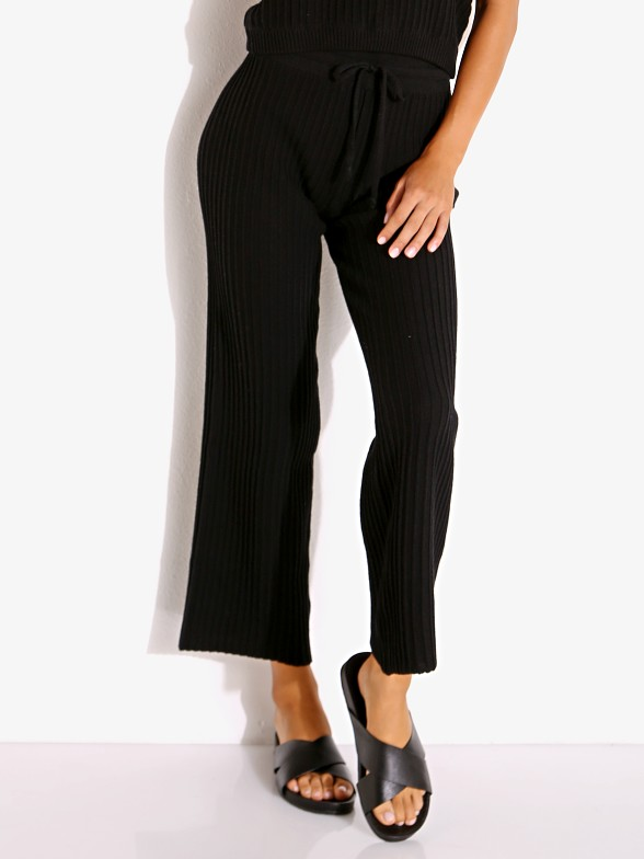 Model in black Rue Stiic Shae Knit Pant