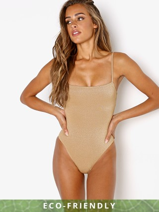 Model in golden glow metallic Vitamin A Jenna One Piece