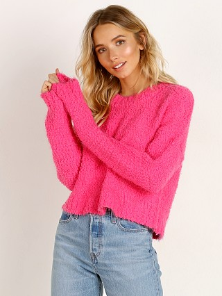 Model in dazzling pink Show Me Your Mumu Cropped Varsity Sweater