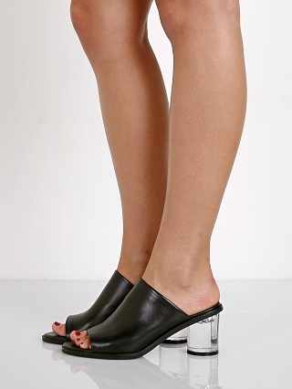 Model in black SOL SANA Queenie Mule