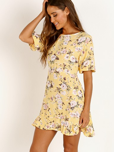 Model in pomeline floral jasmin yellow Faithfull the Brand Jeanette Dress