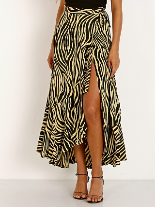 Model in amaia zebra pale yellow Faithfull the Brand Jasper Midi Skirt
