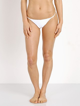 Model in white Kopper & Zink Benji Bikini Bottom